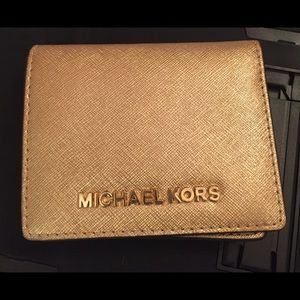 Micheal Kors gold small wallet
